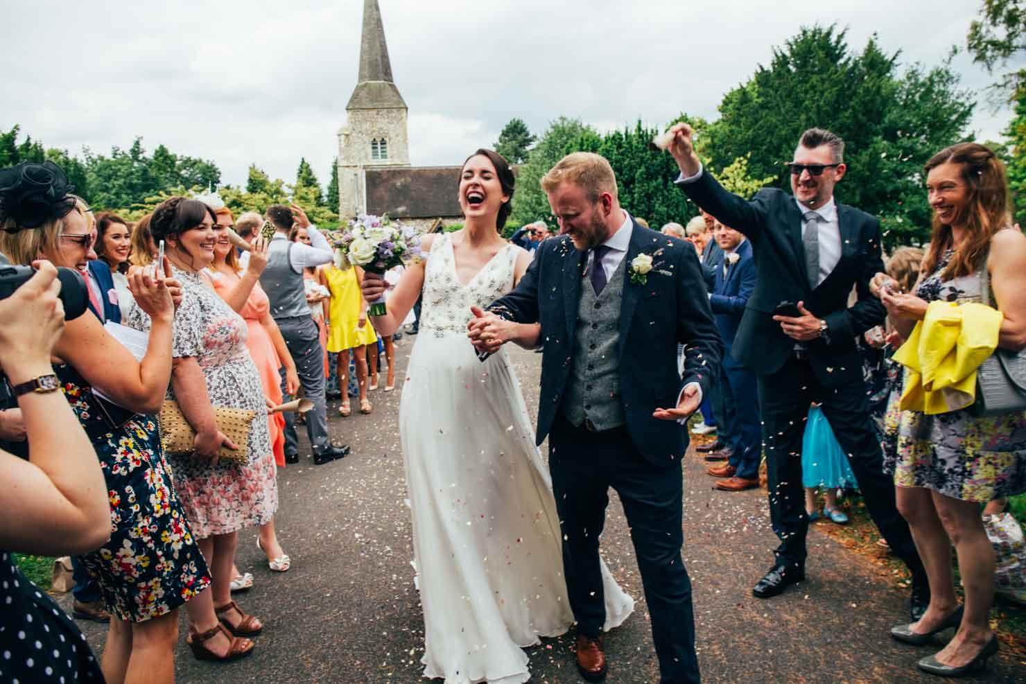 newlyweds down confetti line wedding photography in suffolk