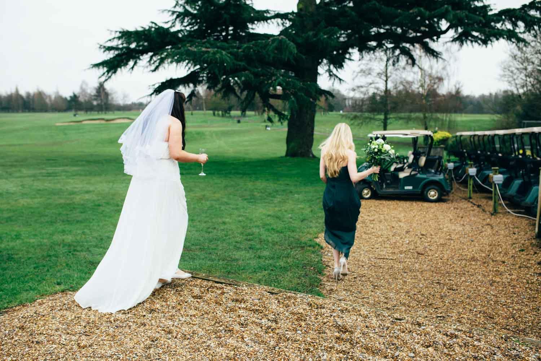 bride and bridesmaid outdoors at hintlesham hall golf club wedding reception