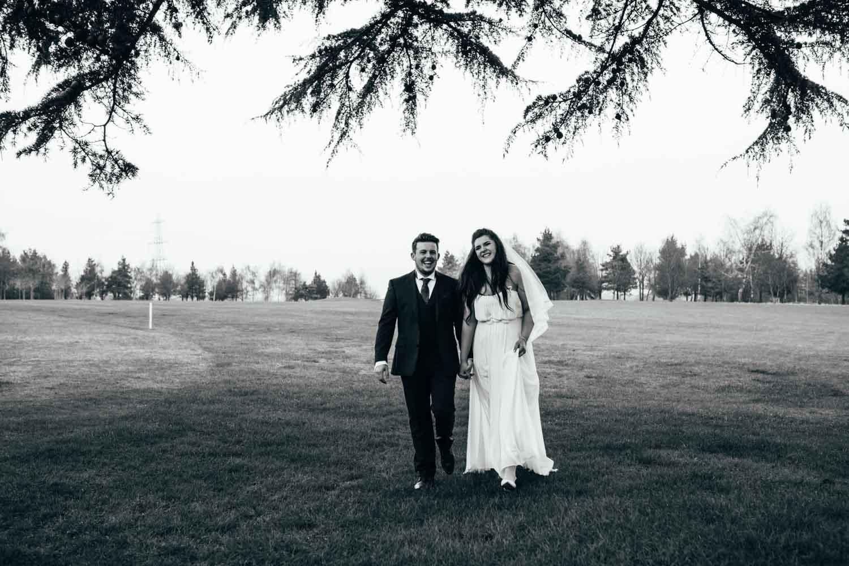 newlywed portraits outdoors at hintlesham hall golf club wedding