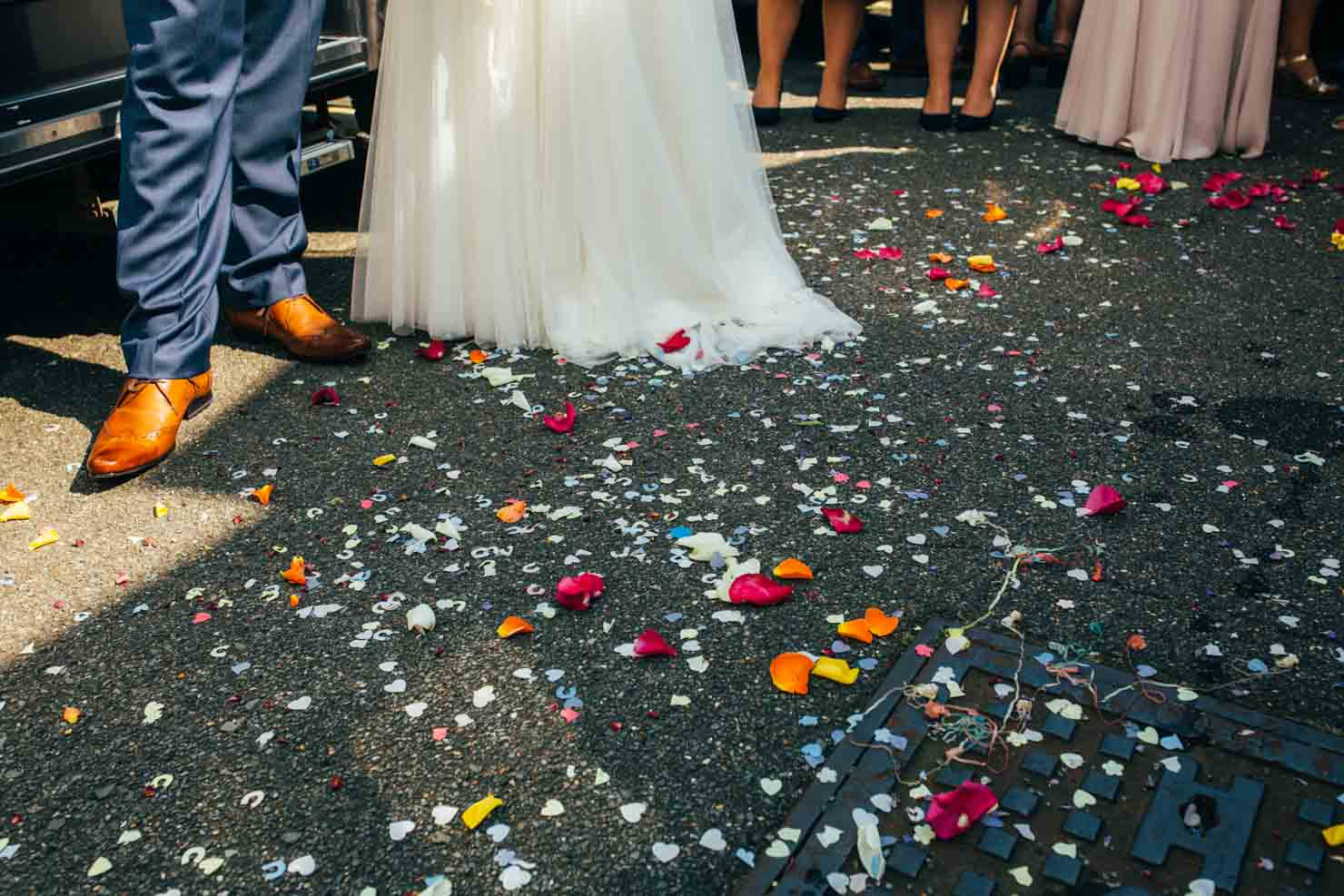 tips for confetti pictures wedding photography colourful confetti on the floor in Ipswich