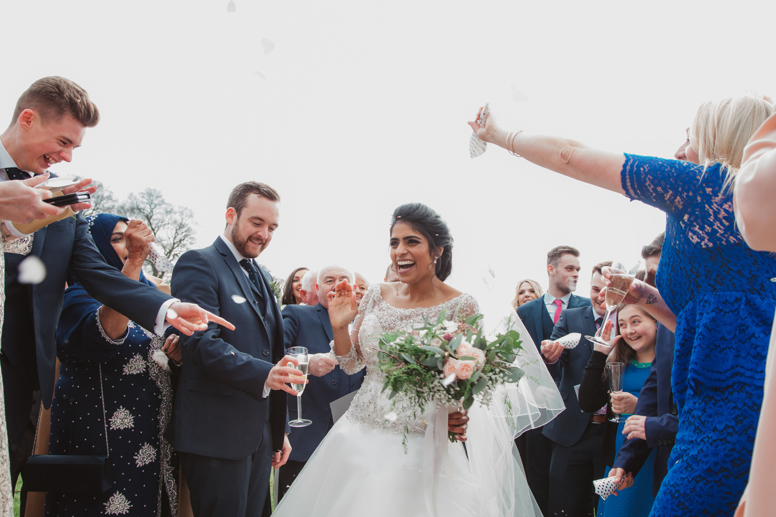 relaxed laughing couple at unique suffolk wedding venue