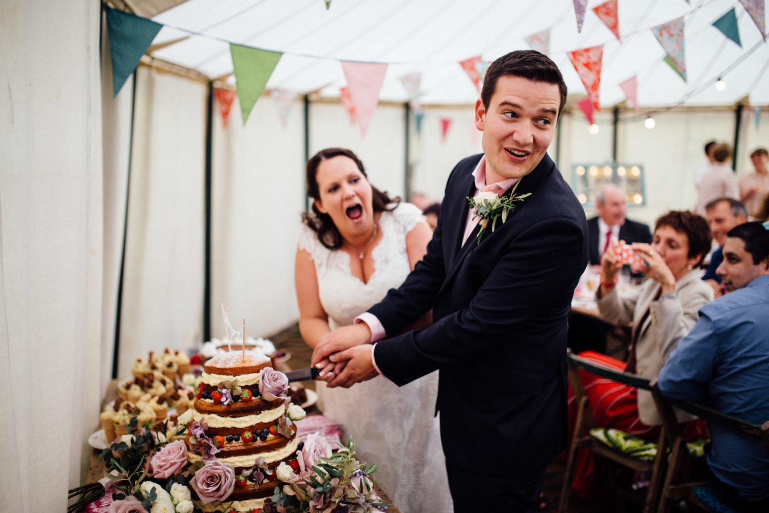 introvert bride and groom cutting cake in keeper and the dell marquee