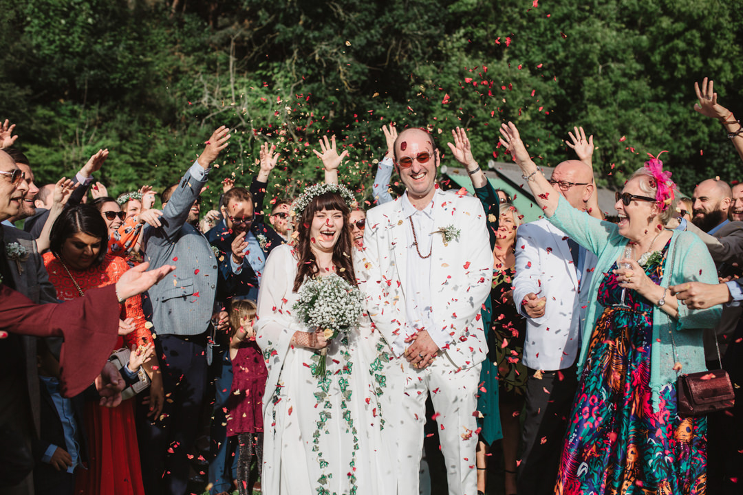 Confetti throw over bride and groom in white at keeper and the dell wedding