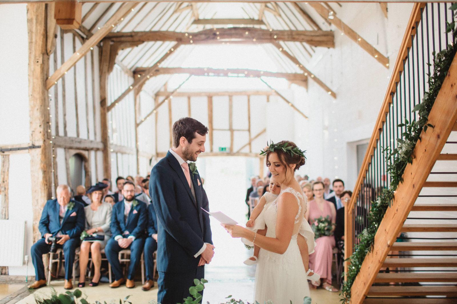 bride and groom saying vows at unique suffolk wedding venue dove barn
