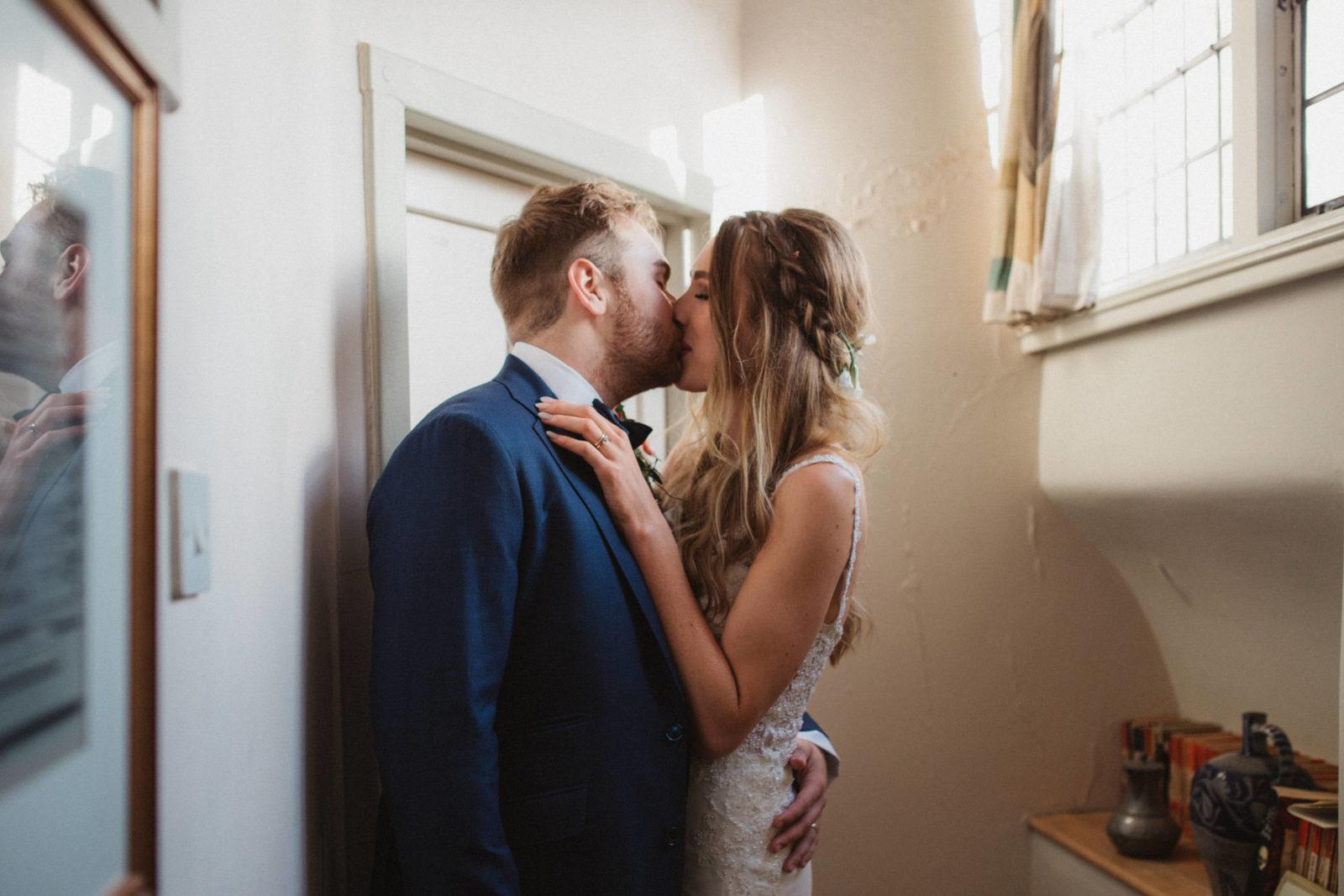 bride and groom kissing at unique suffolk wedding venue butley priory