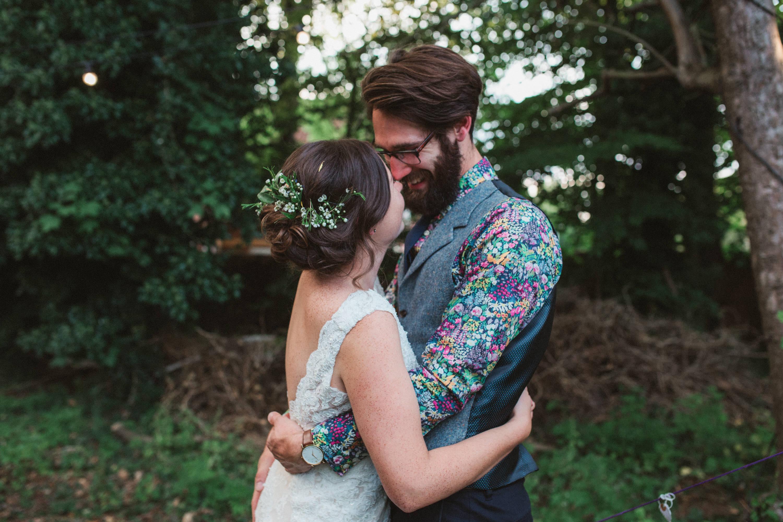 bride and groom hugging at unique suffolk wedding venue
