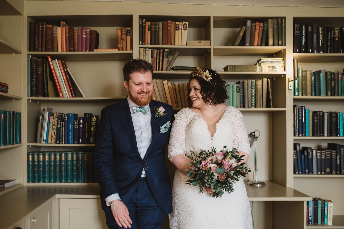 couples portraits in the library at bruisyard hall after the wedding