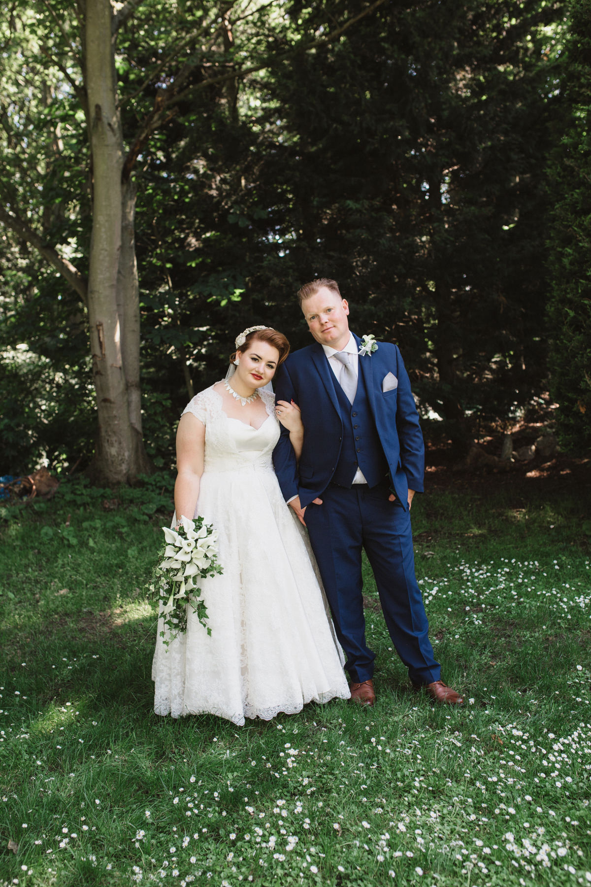 bride and groom outside in garden at OLD RECTORY CROSTWICK WEDDING PHOTOGRAPHY