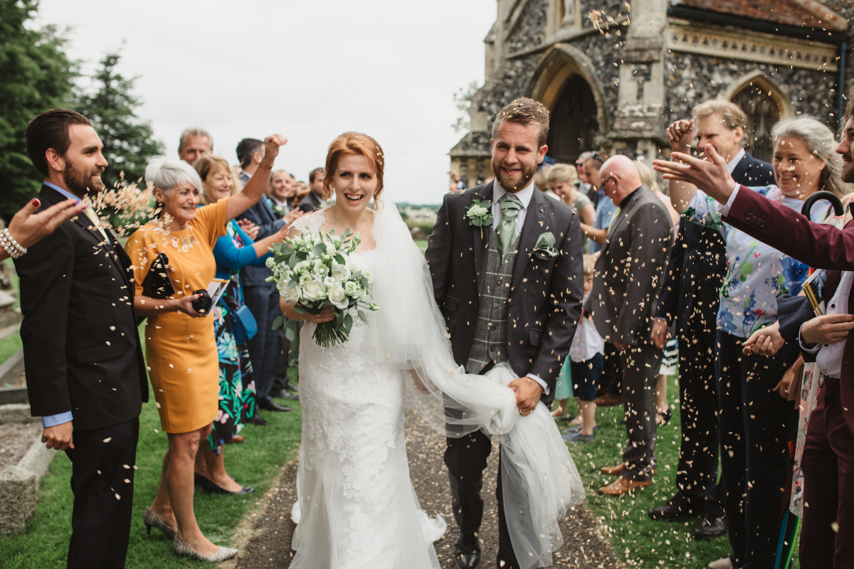 relaxed stowmarket wedding photography confetti line st andrews church