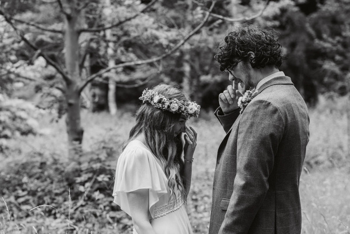 bride and groom sharing a moment at Oak Lodge Thetford Forest Wedding Photography