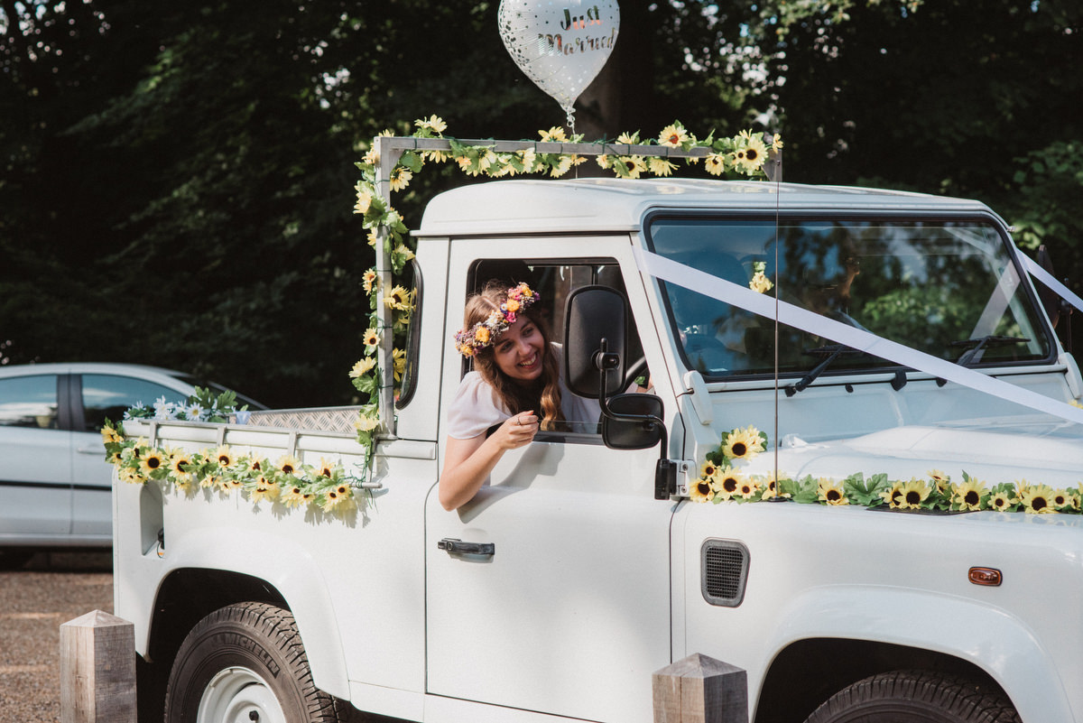 Bride in Land Rover at Oak Lodge Thetford Forest Wedding Photography