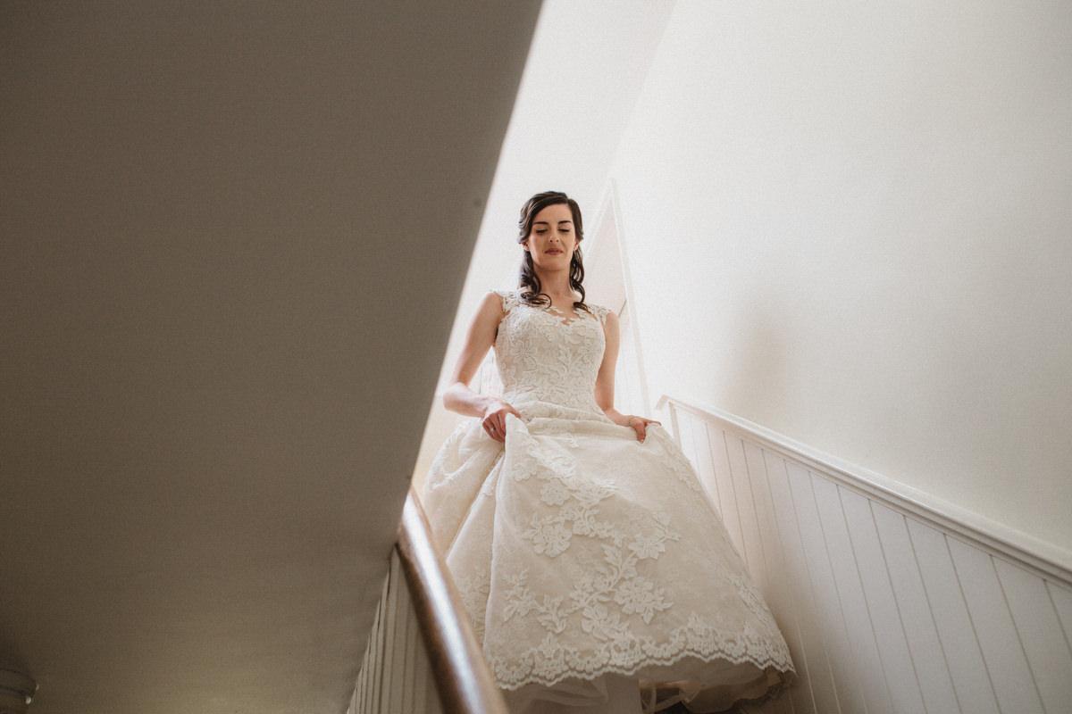 bridal prep at the farmhouse at bride and groom portraits at HAUGHLEY PARK BARN WEDDING PHOTOGRAPHY