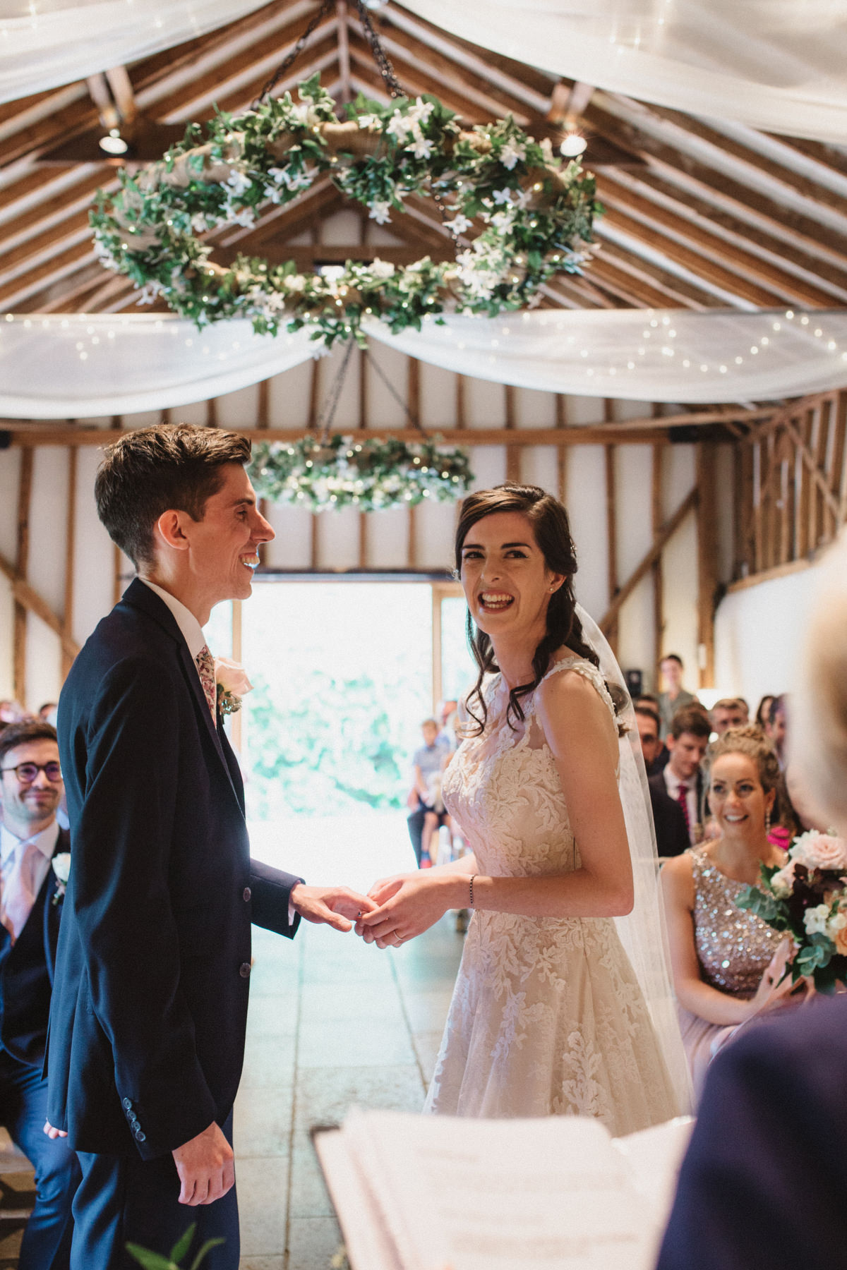 bride and groom laughing at bride and groom portraits at HAUGHLEY PARK BARN WEDDING PHOTOGRAPHY