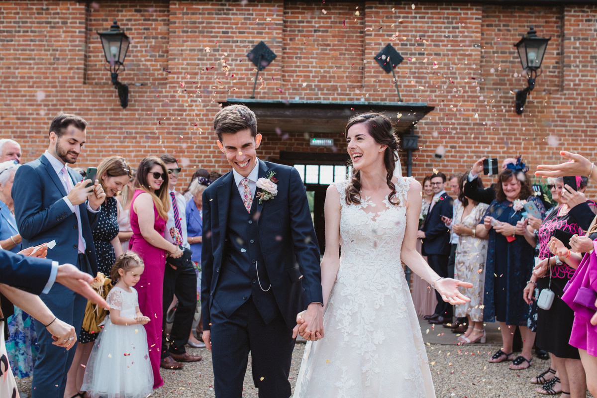 Confetti outside at HAUGHLEY PARK BARN WEDDING PHOTOGRAPHY