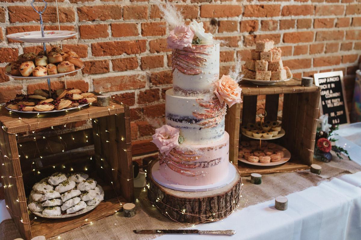 beth haxby wedding cake at HAUGHLEY PARK BARN WEDDING PHOTOGRAPHY