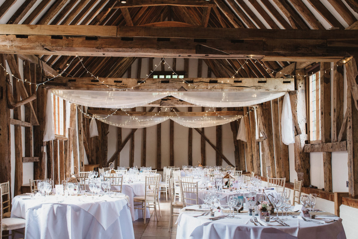 HAUGHLEY PARK BARN set up for the wedding reception in suffolk