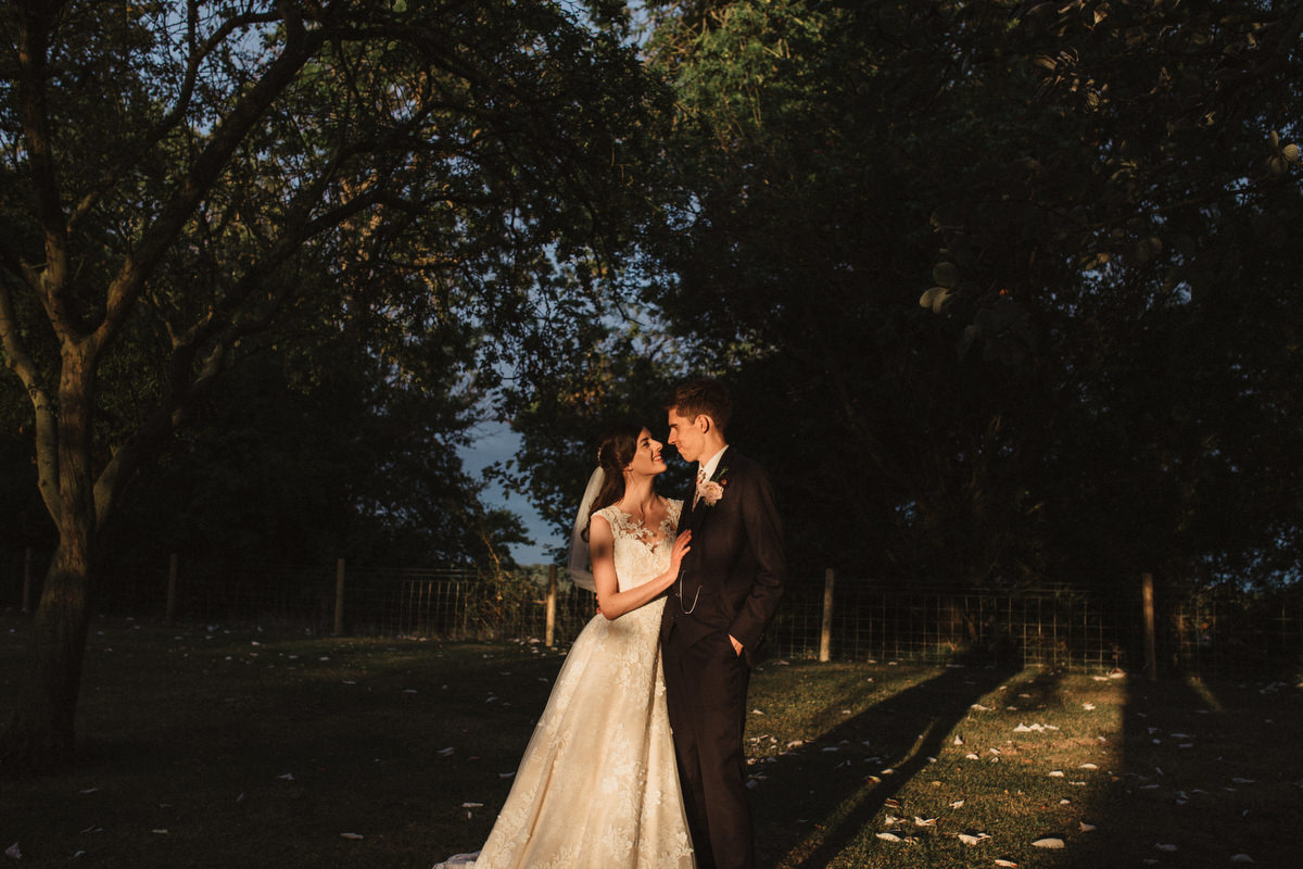 bride and groom portraits at golden hour at Haughley Park barn