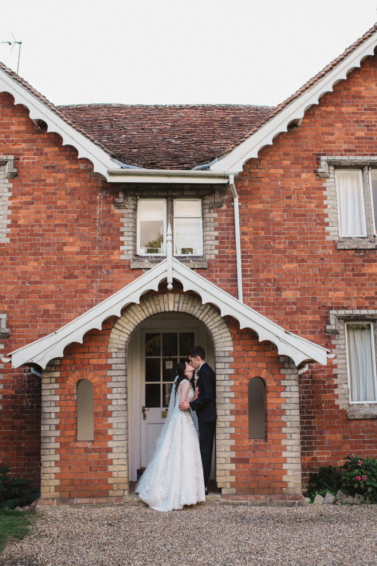 The farmhouse at HAUGHLEY PARK BARN WEDDING PHOTOGRAPHY